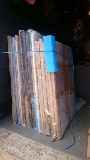 Paintings packaged in the van ready to be taken to an exhibition