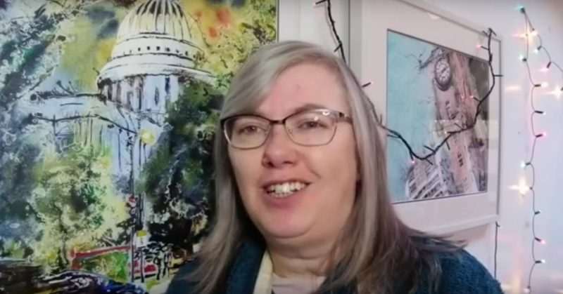 Cathy Read Still from Video Singing Merry Christmas